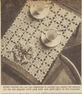 Black and white photograph of a thread crochet traycloth made up of star motifs