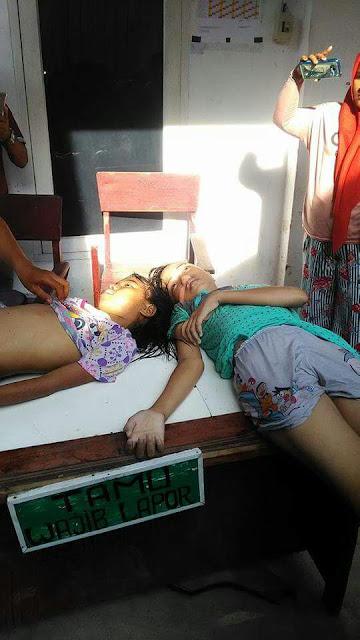 Dua orang siswi SMP Kota Tanjungbalai yang meninggal dunia karena tenggelam di Sungai Selat Lancang, Tanjungbalai,
