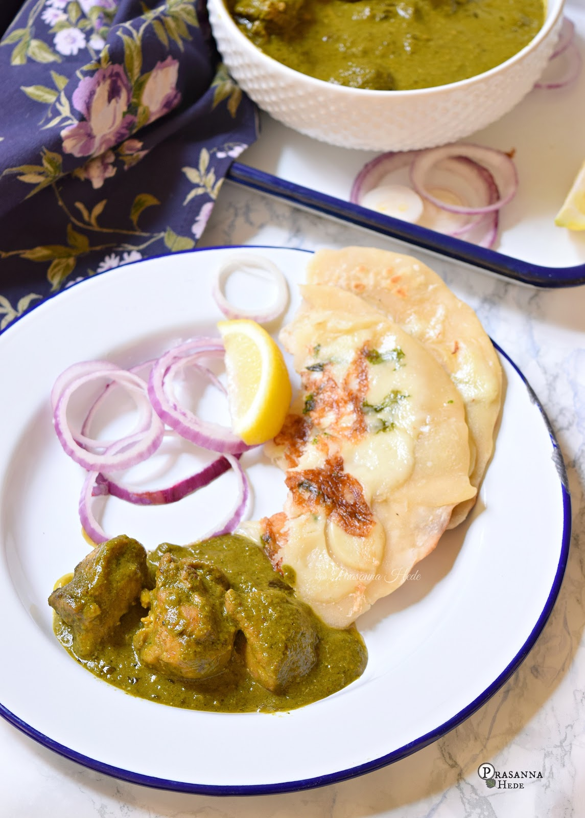 A closer look of white plate with spinach chicken curry and naan