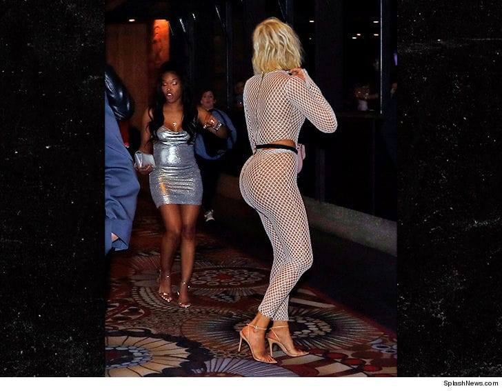 Khloe Kardashian hourglass curves in fishnet catsuit
