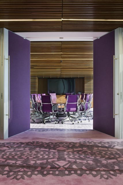 Photo of meeting room with purple doors and purple furniture