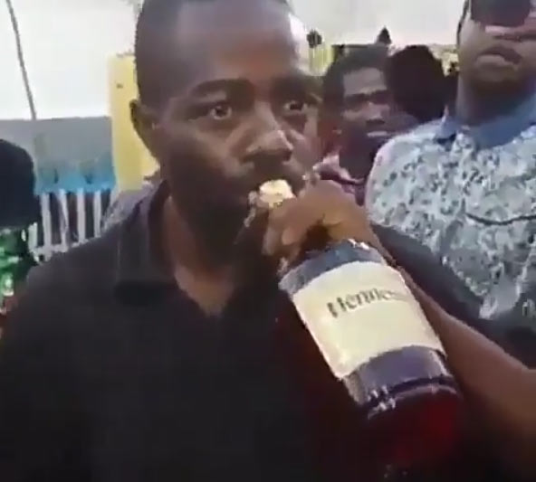 Man finishes a bottle of Hennessy at once without removing bottle from mouth