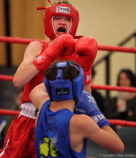 Quinn Fogerty (red), Central Hawke's Bay; Darrius Tregoweth (blue), Feilding - Open 15 years 56kg 3 x 2 minute rounds - Giants Boxing Academy Tournament at Hastings Intermediate School, Hastings. photograph