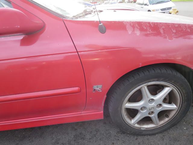 Peeling paint on Nissan Sentra SE-R before repaint at Almost Everything Auto Body