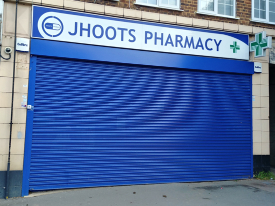 Lunchtime and Saturdays at Jhoots Pharmacy, Brookmans Park  We've suggested they put the correct opening times on the shutters  Image by North Mymms News released under Creative Commons BY-NC-SA 4.0