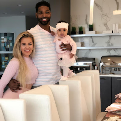 Khloe with partner Tristan and baby True