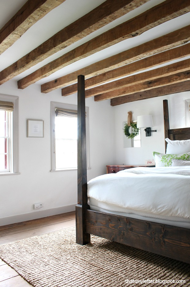 Exposed wood beams in master bedroom