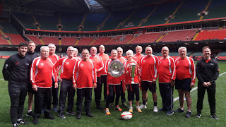 Pontyclun walking rugby team with triple crown and 6 nations trophies