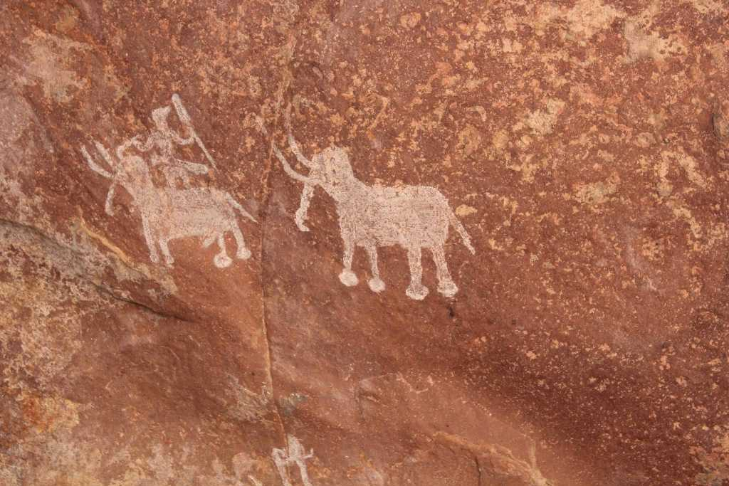 Bhimbetka rock paintings - hunting scene - prehistoric archaeological site, India