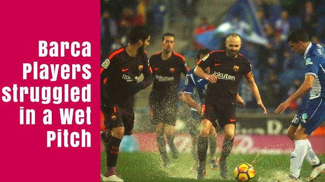 Iniesta surrounded by Espanyol Players in 1-1 draw between FC Barcelona and Espanyol