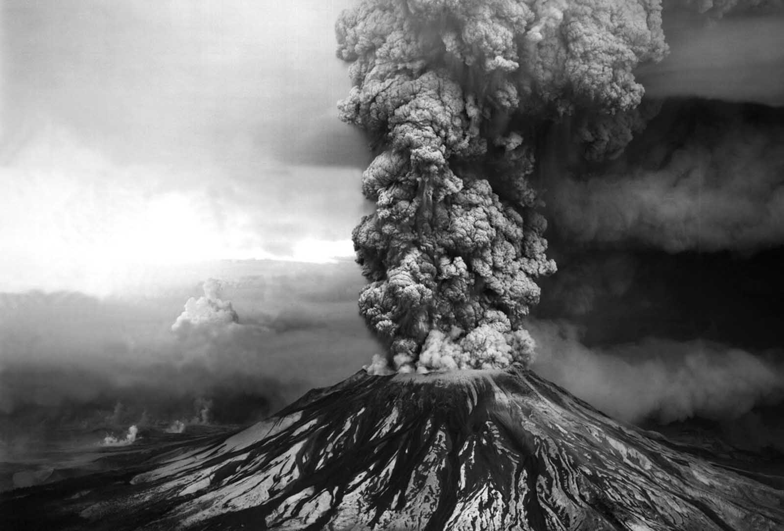 An ash plume billows from the crater atop Mount St. Helens hours after its eruption began on May 18th, 1980, in Washington state. The column of ash and gas reached 15 miles into the atmosphere, depositing ash across a dozen states.