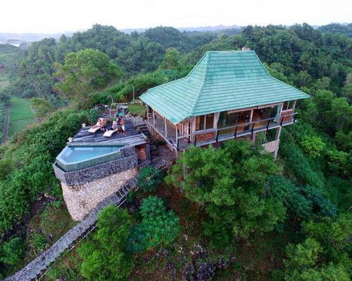 Tinuku.com Villa Batu Hill designed Joglo Javanese architecture perched on hilltop for view Watu Karung beach