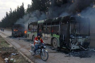 Rebel burn evacuation buses in Syria