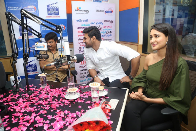 Pragya Jaiswal in a single Sleeves Off Shoulder Green Top Black Leggings promoting JJN Movie at Radio City 10.08.2017 002.JPG