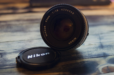 Nikon DSLR Camera Lens Photo by Connor Hancovsky - https://unsplash.com/photos/bZ30gBgTTb4