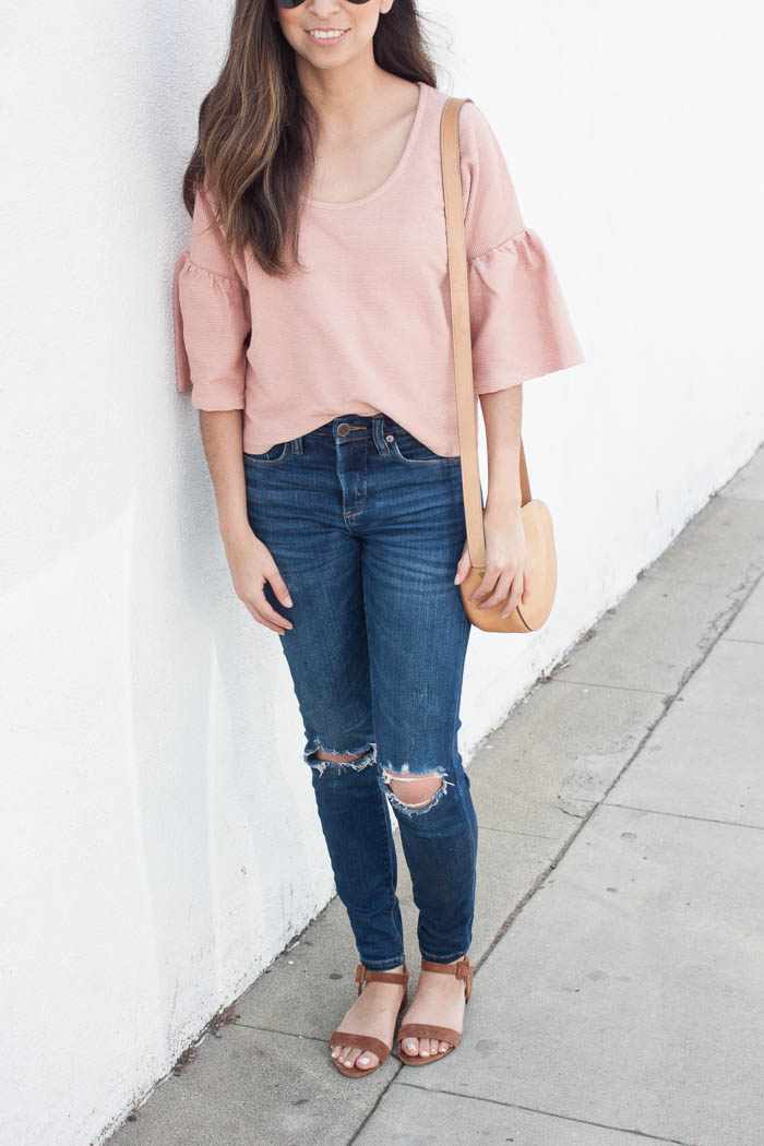 cute blush tshirt and distressed jeans