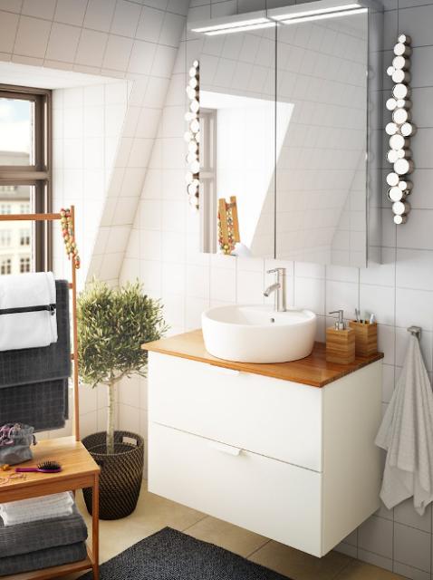 A beautiful sink shape for a narrow bathroom.