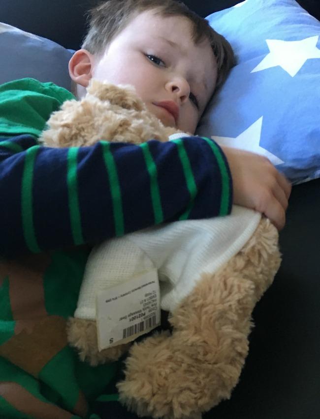 boy-cuddling-teddy-bear