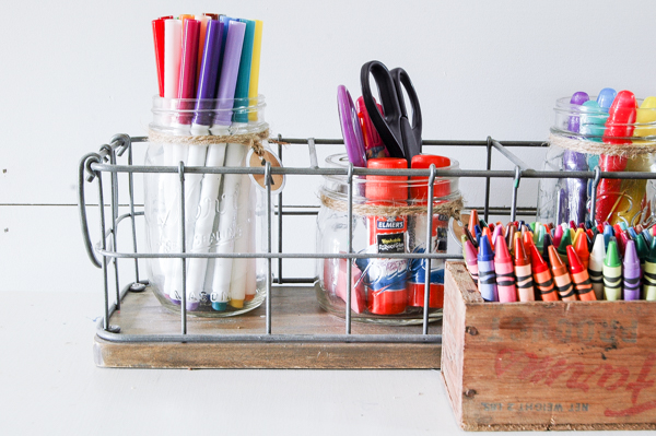 An industrial storage caddy and vintage wood box make for the perfect STYLISH and ORGANIZED art supply storage for kids. www.littlehouseoffour.com