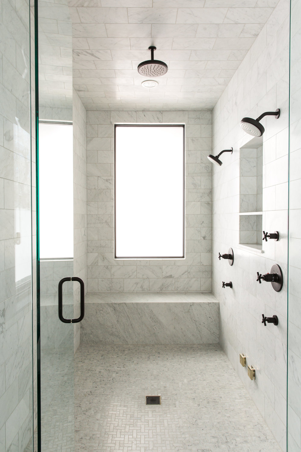 Luxury marble tile shower in modern mountain house