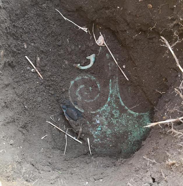Horned bronze figure and ritual axe found in Denmark