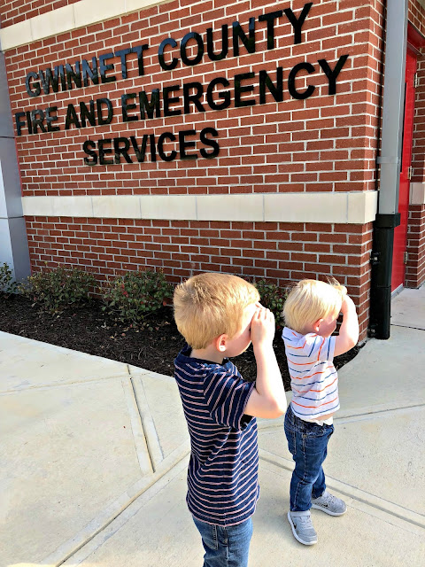 Brothers looking into horizon at the fire station