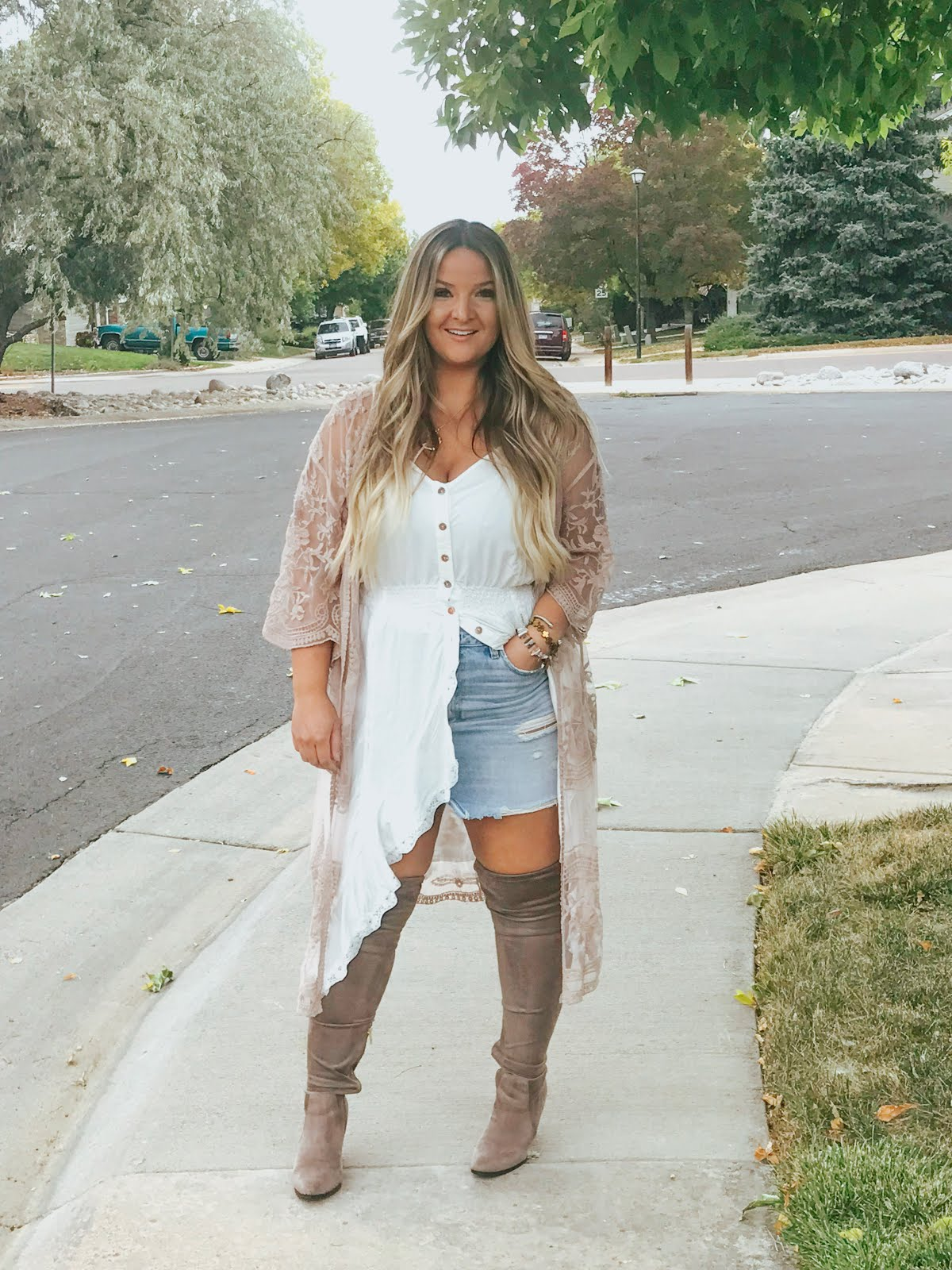 Lace Kimonos for Fall featured by top Denver fashion blog, Delayna Denaye: Blonde woman wearing a blush lace kimono, Vici lace camisole, Abercombie denim skirt, Target Over the Knee boots, Amazon initial necklace and cuff bracelet