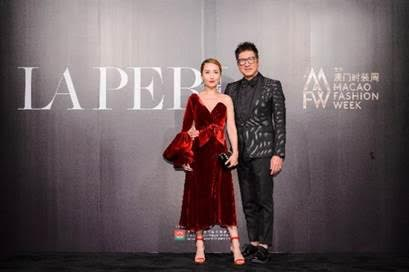 Hong Kong celebrity couple singer and television presenter Paisley Wu Pui Wei and actor and musician Palmerson Sinn Lap Man at the Sands Macao Fashion Week gala dinner.