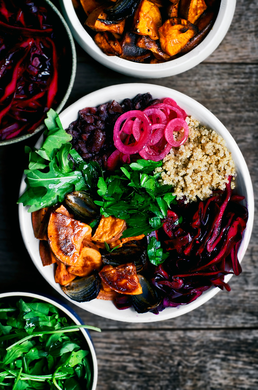 Vegan sweet potato bowls, inspired by Mexican flavours and using what's available in northern Europe in winter. Red cabbage, pickled onions, quinoa, and kidney beans are featured here with greens and plenty of spices for an easy, colourful meal.