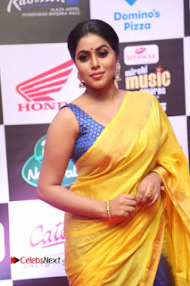 Actress Poorna Pictures in Yellow Saree at Mirchi Music Awards South 2015  0010.JPG