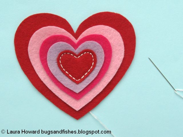 Sewing the first felt heart in place