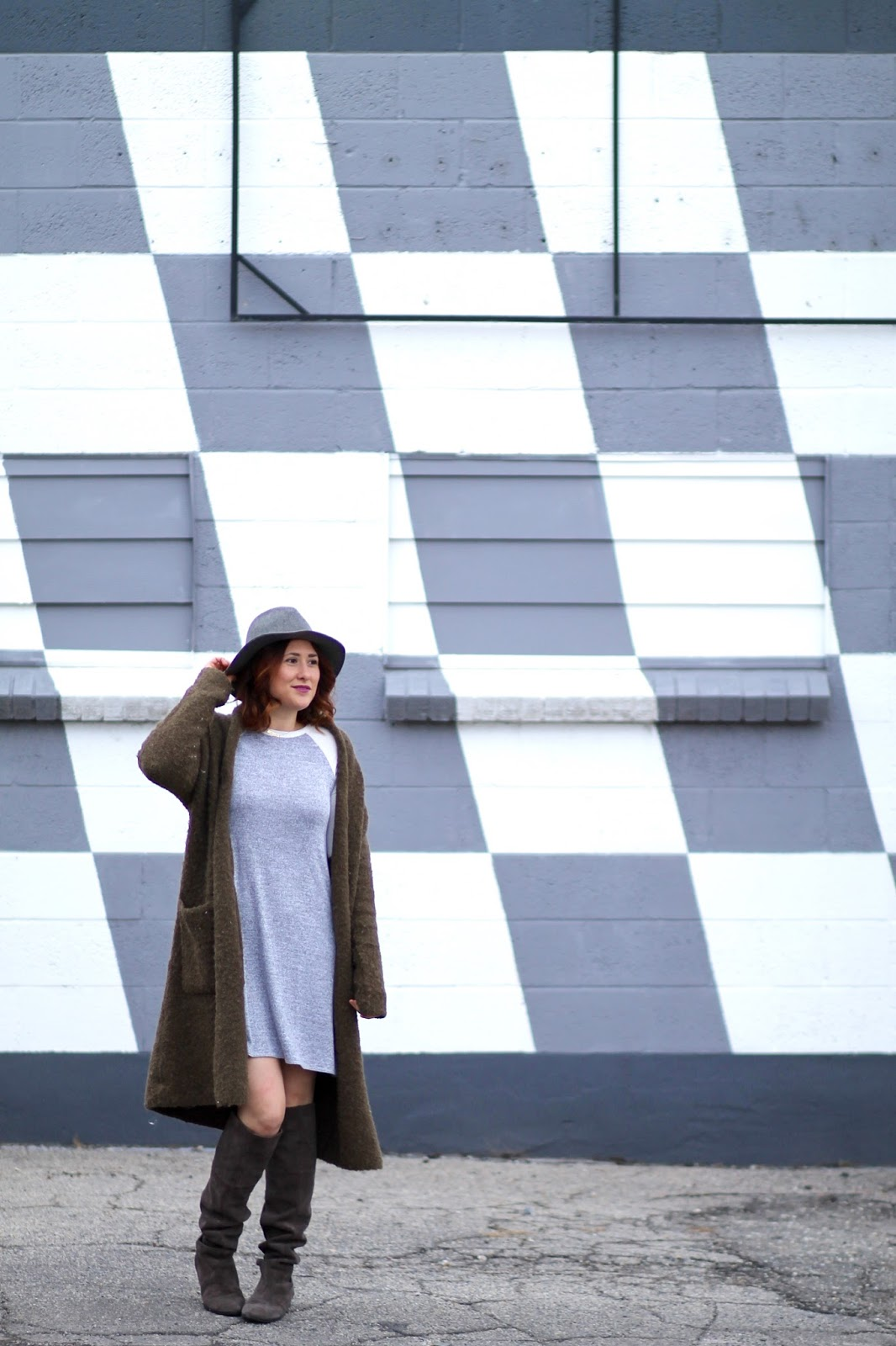 long cardigan in olive grreen by masion scotch. over the knee boots and gray fedora, Mac heroine