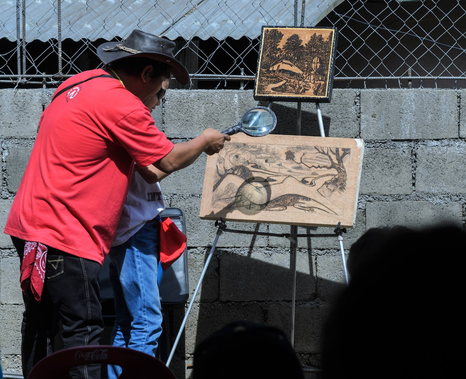 International Arts Festival 8th Tam-awan Baguio City Philippines Solar Sun Painting by Jordan Mang-Osan with a another workshop youth volunteered being shown how to solar paint