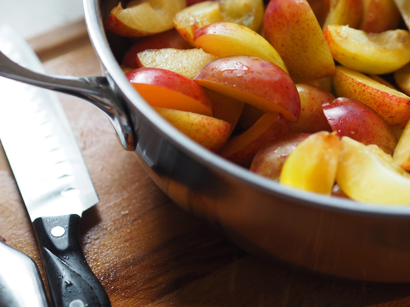 Knife and Chopped Plums