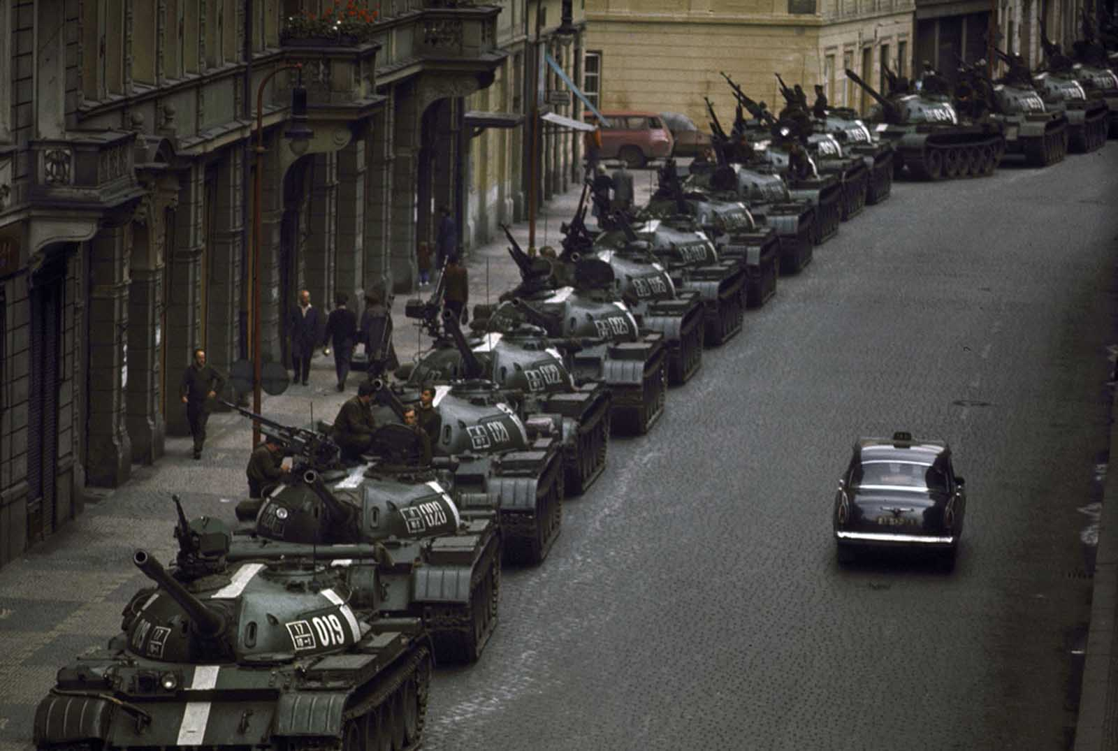 A lone car passes dozens of Soviet tanks during the 1968 invasion of Czechoslovakia.