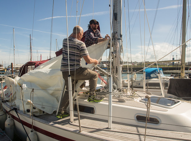 Photo of Phil helping a friend with his sails