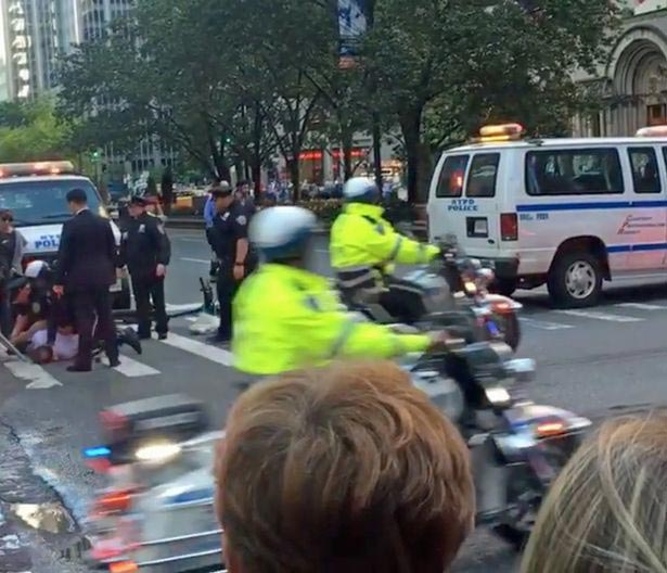 Biker slammed to the ground by police when he tried to cross Obama's convoy