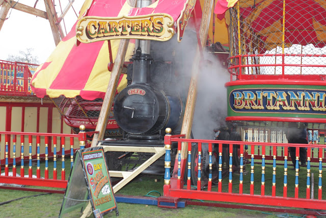 Carters Steam Fair Britannia Ride Showing Steam.