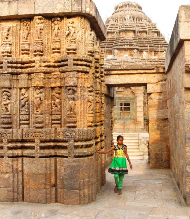 A Young dancer prancing through the apsara walls of Konark Sun Temple