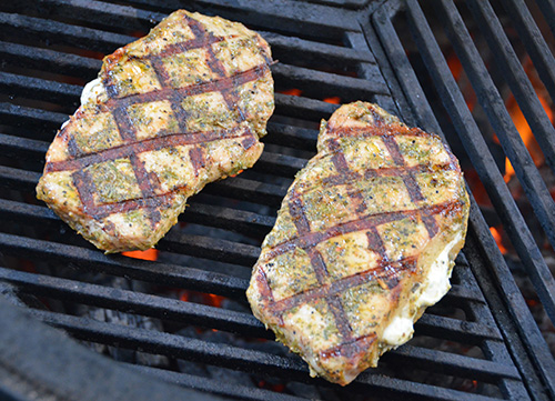 Smithfield Roasted Garlic and Herb Pork Chops on the Big Green Egg kamado grill using Craycort cast iron grates #realflavorrealfast