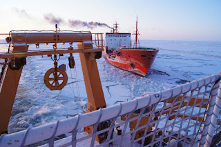 The Bering Sea is a volatile police, with powerful storms and changing sea ice. Here, a ship plows through the ice toward Nome, Alaska, in January 2012. (Credit: U.S. Coast Guard/Getty Images) Click to Enlarge.