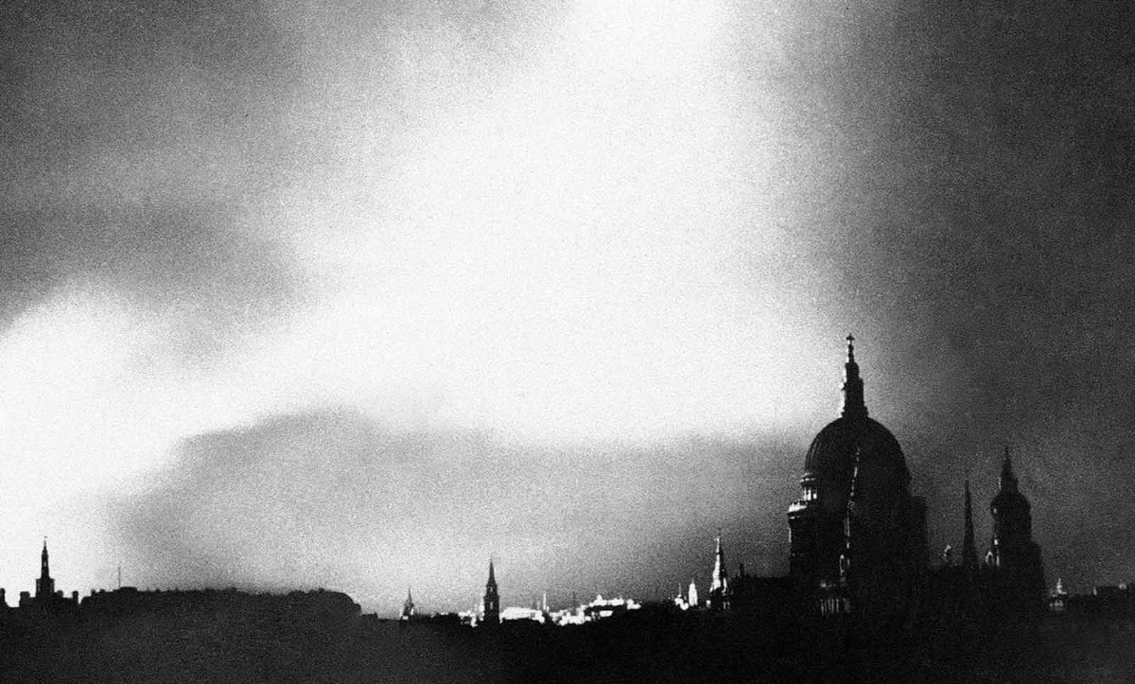Fires rage in the city of London after a lone German bomber had dropped incendiary bombs close to the heart of the city on September 1, 1940.