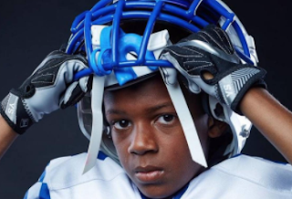 A 9-year-old football player gets a college scholarship offer? Yep, you bet!
