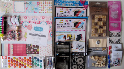 A range of paper craft supplies arranged on a desktop.