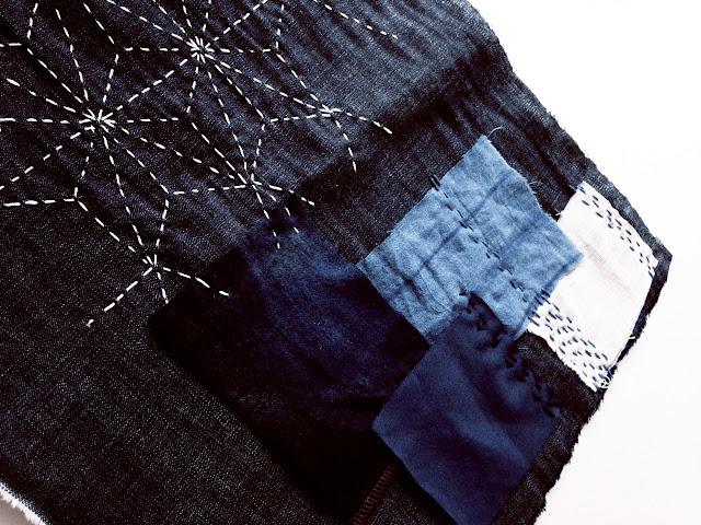 Sashiko stitching and patchwork on indigo cloth © Laura Luchtman