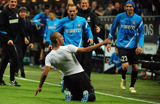 Inter Milan player Maicon celebrates after scoring against AC Milan