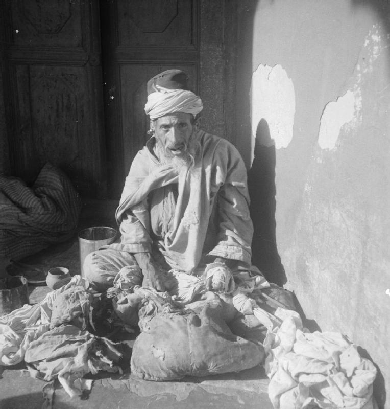 A rag merchant displaying his wares outside the Jama Masjid Mosque, Old Delhi - 1944