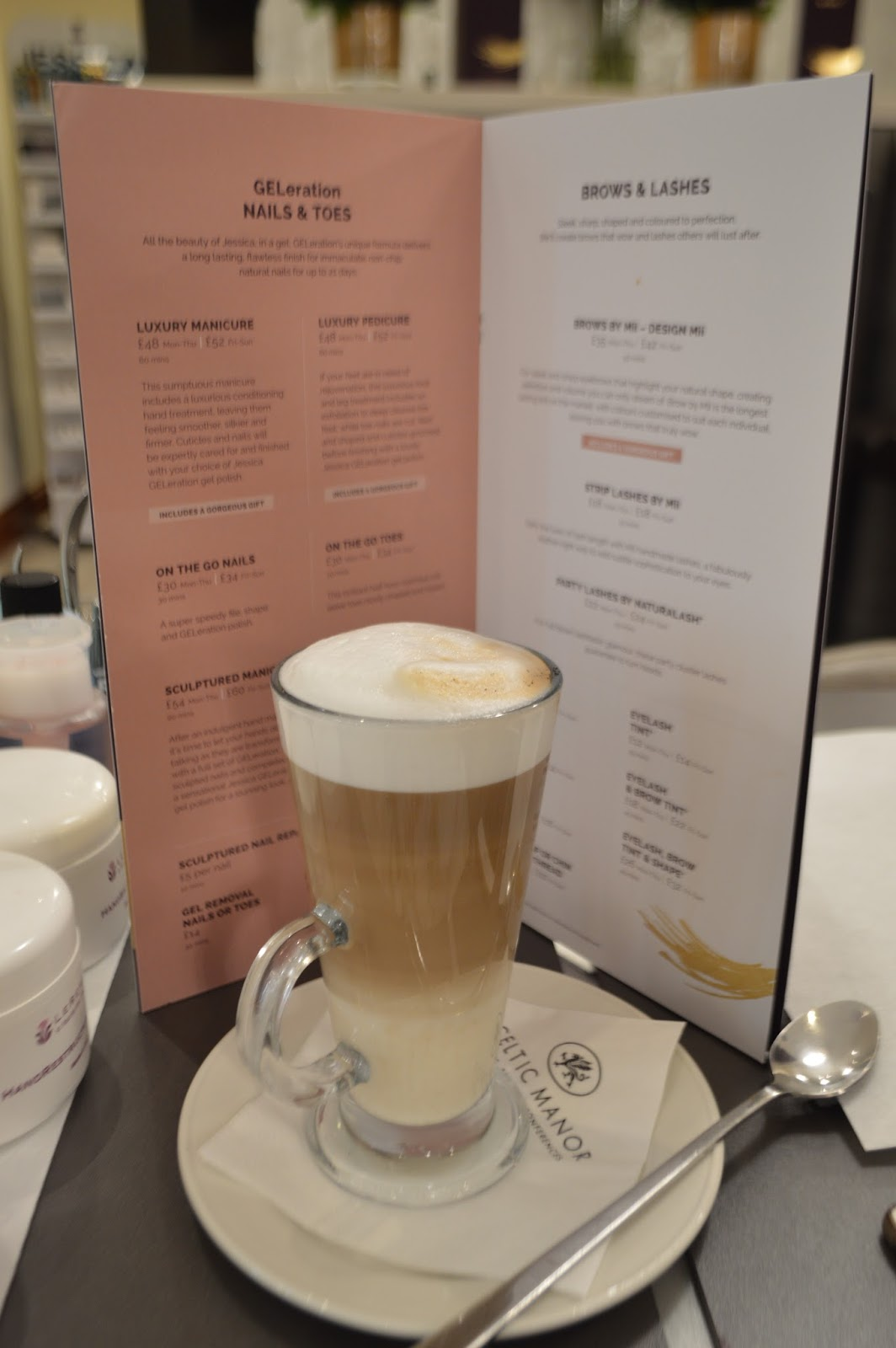 this is a picture of a latte at the cleric manor champagne and beauty bar