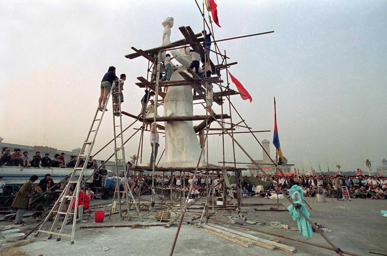 Beijing University students put the finishing touches on the Goddess of Democracy in Tiananmen Square, on May 30, 1989.