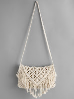 http://fr.shein.com/Crochet-Hollow-Out-Tassel-Bag-p-349440-cat-1764.html?utm_source=melimelook.fr&utm_medium=blogger&url_from=melimelook